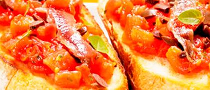 Bruschetta de tomate com anchova()